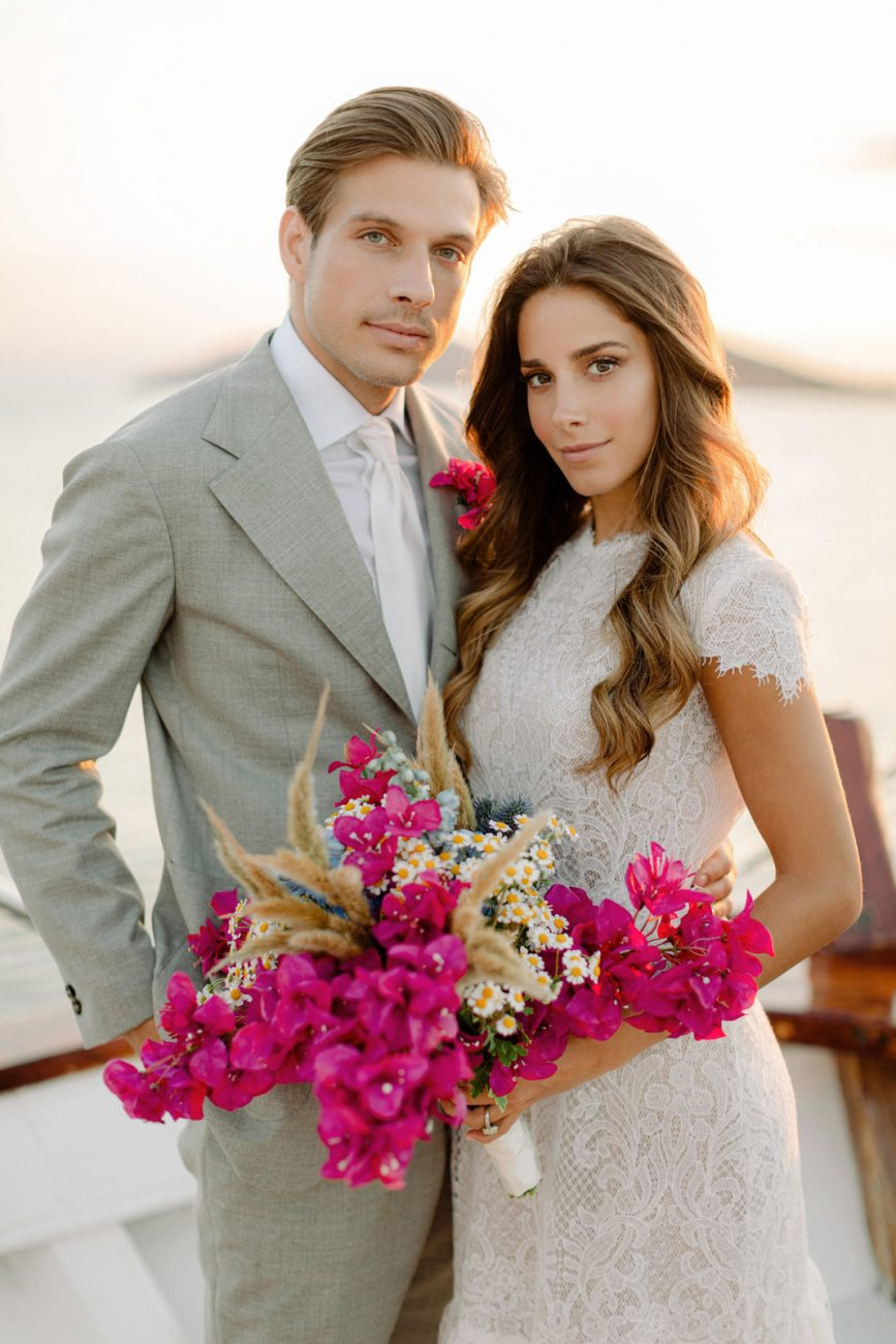 Mykonos wedding photographer captures couple on the deck of a boat after their wedding ceremony