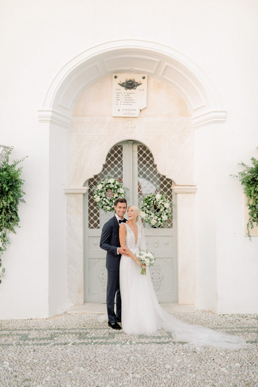 Portrait of stylish couple outside os church in Spetses Greece
