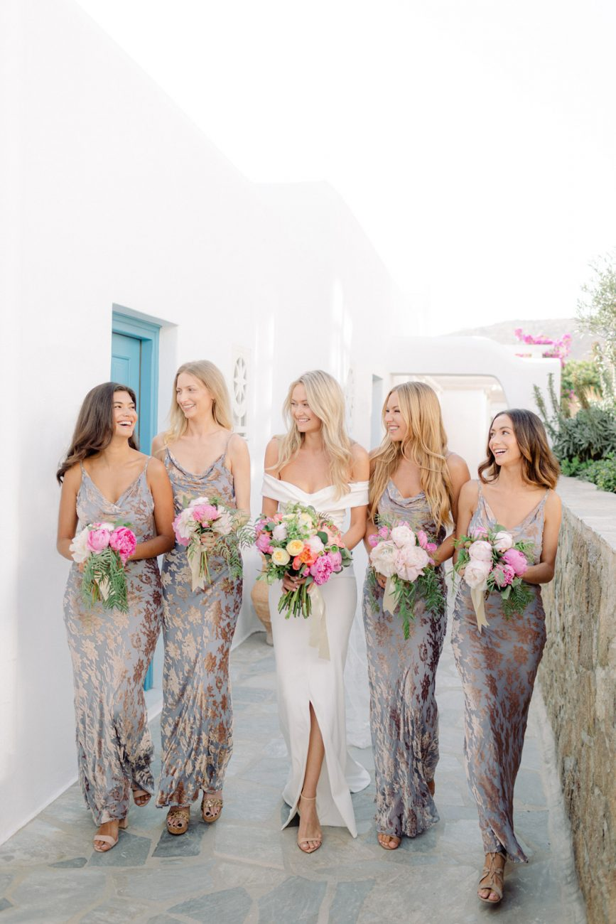 Mykonos brides with brides maids wearing floral with grey tones dresses
