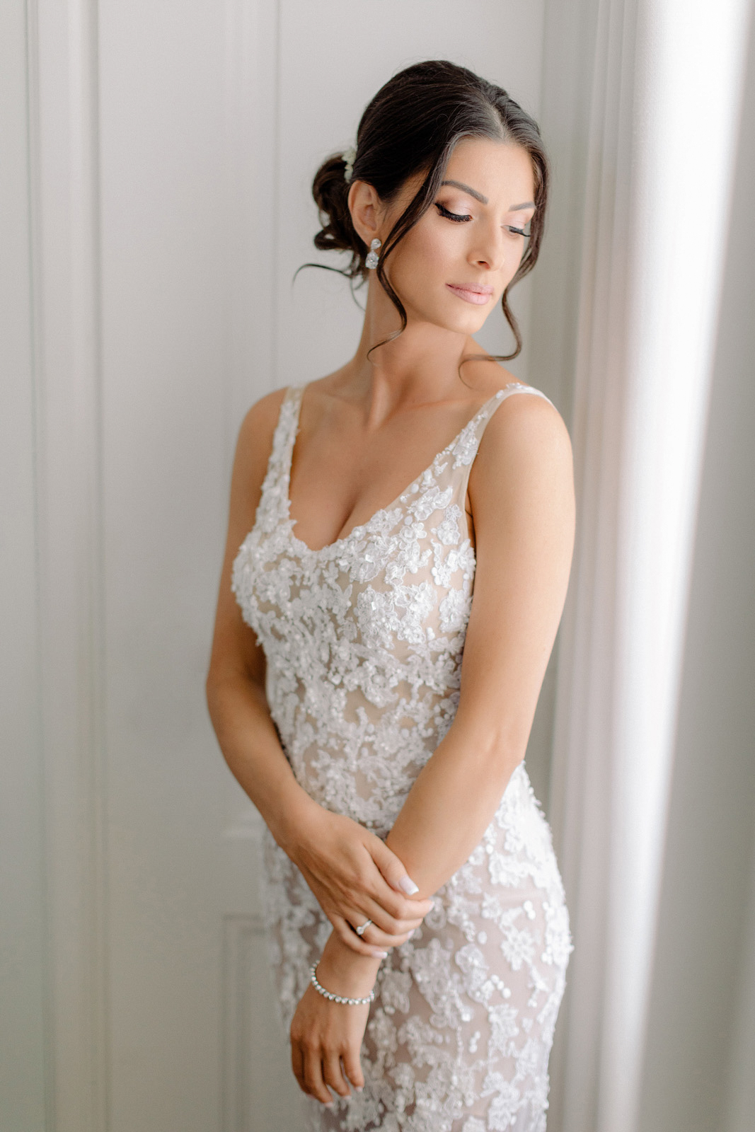spetses wedding photographer makes portrait of gorgeous bride by the window of Grand Hotel Poseidonion suite